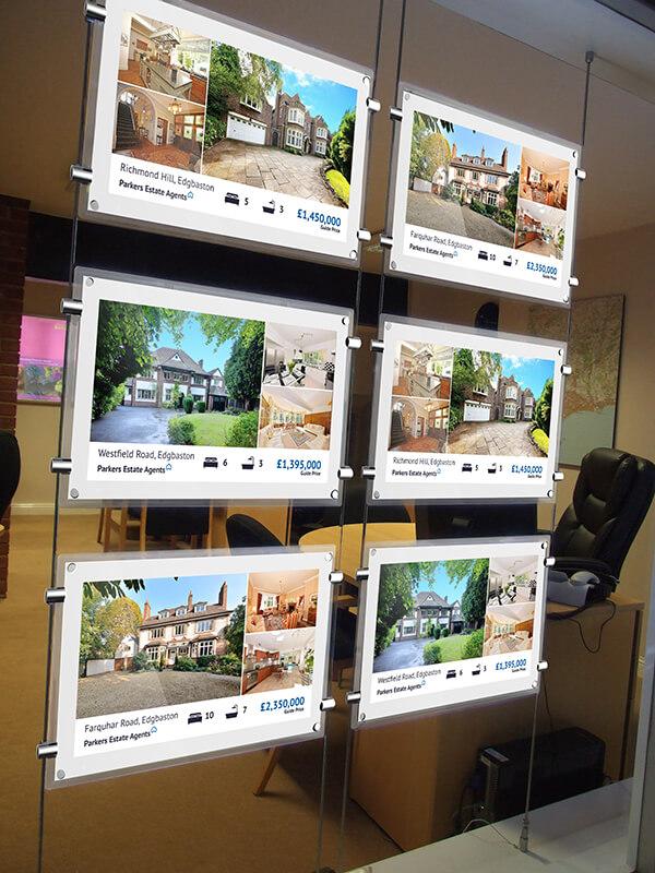 Ecran vitrine affichage agence immobilière